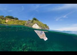 Plastic bottle floating in ocean