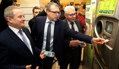 Image of former Environment Minister using reverse vending machine